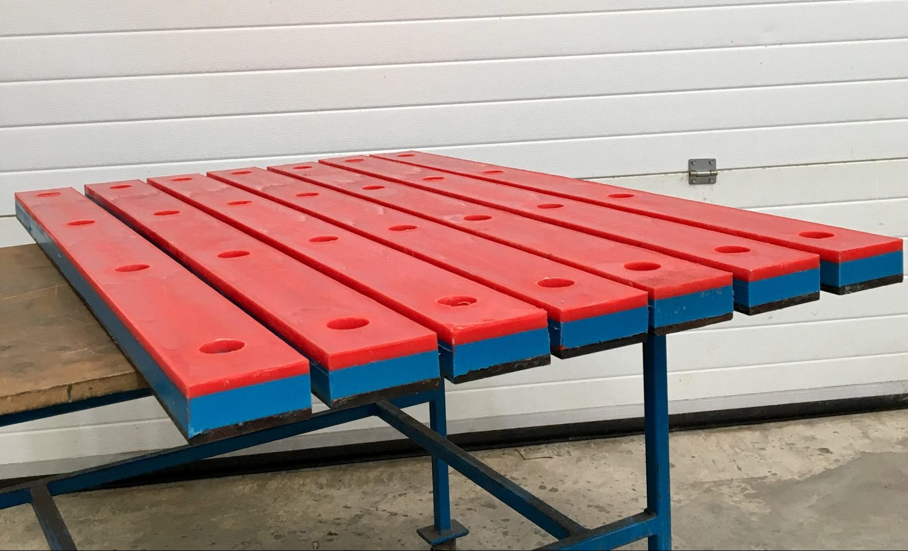 Dual hardness impact bars for the construction industry